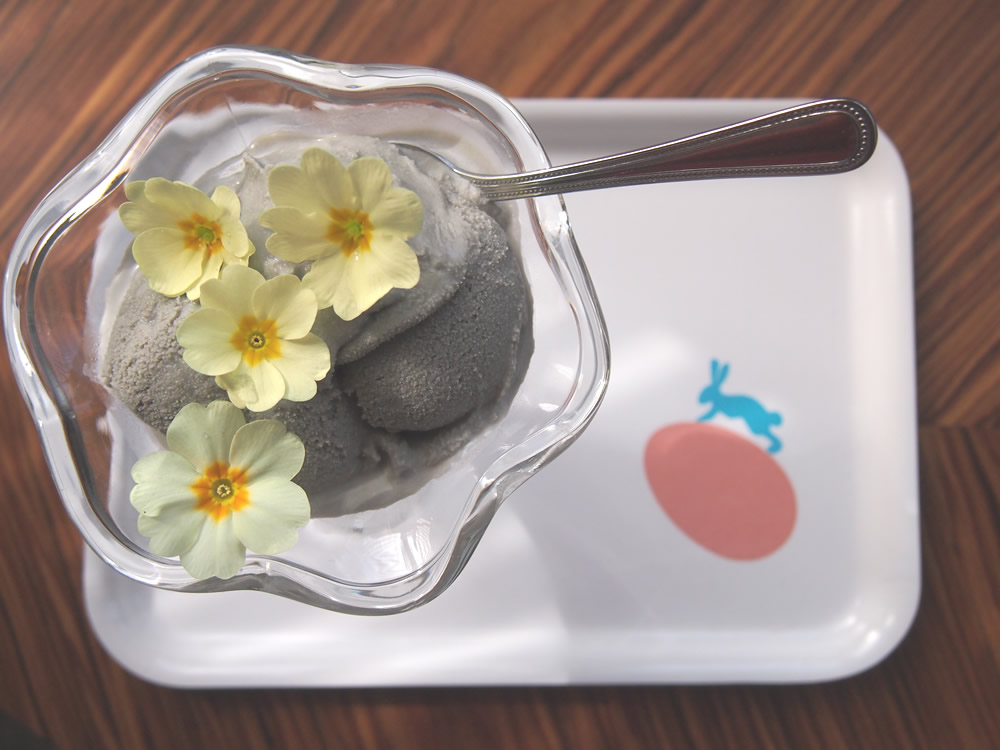 Edible primrose flowers with liquorice ice cream