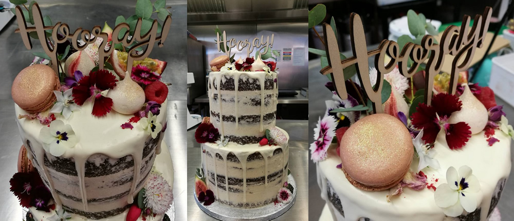 Edible flowers used on a wedding cake by Amy Fish